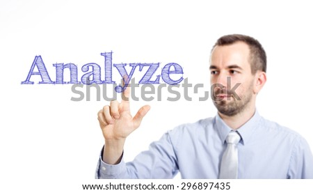 Analyze Young businessman with small beard touching text - stock photo
