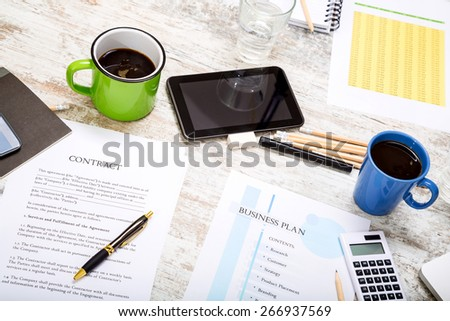Analyzing a Contract and a Business Plan  - stock photo