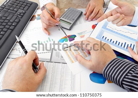 Analyzing Data  Closeup of Hands with Financial  Charts  at Business Meeting in the Office - stock photo