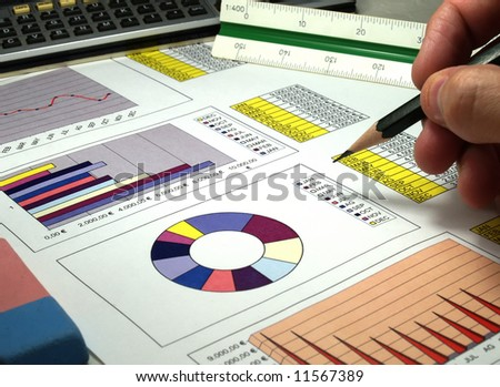 Analyzing financial reports - stock photo