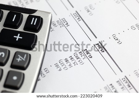 Analyzing financial statement. - stock photo