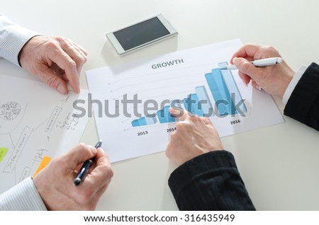 Analyzing growing results on a graphic - stock photo