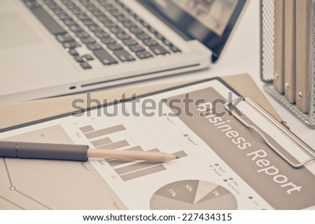 Analyzing investment charts with laptop. Accounting