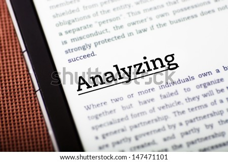 Analyzing on tablet pc screen, ebook concept - stock photo