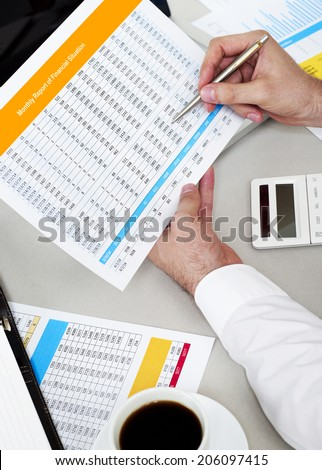 Analyzing spreadsheet - stock photo