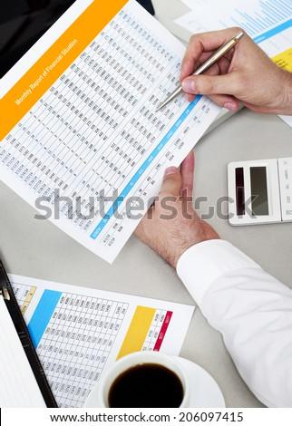 Analyzing spreadsheet - stock photo