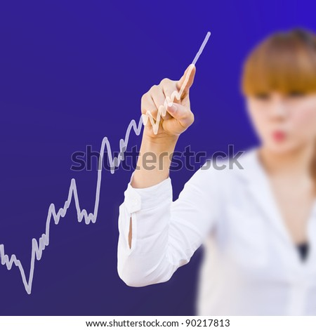 Analyzing stock market graph on a touch with businesswoman - stock photo