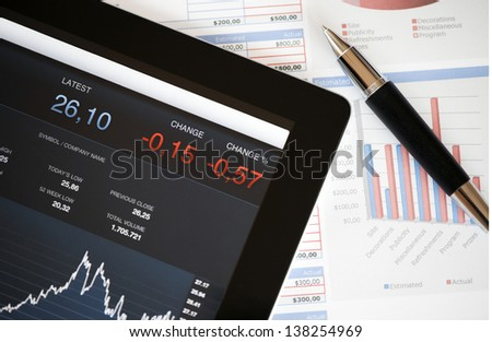 Analyzing stock market with digital tablet. - stock photo