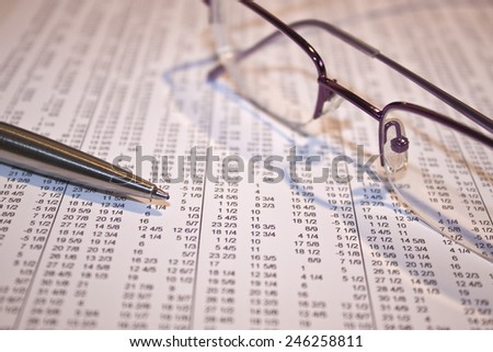 analyzing the stock market for movers and investment - stock photo