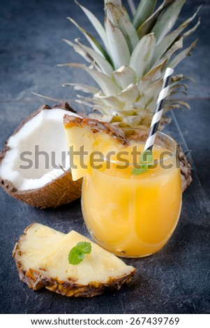 Ananas juice in the glass,selective focus - stock photo