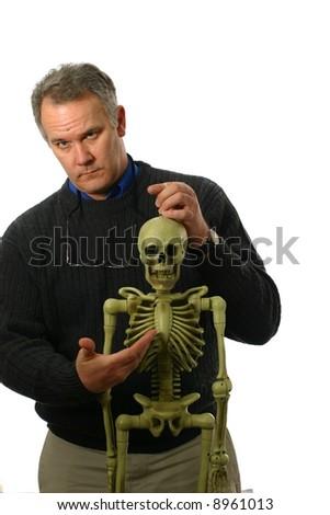 Anatomy teacher with skeleton - stock photo
