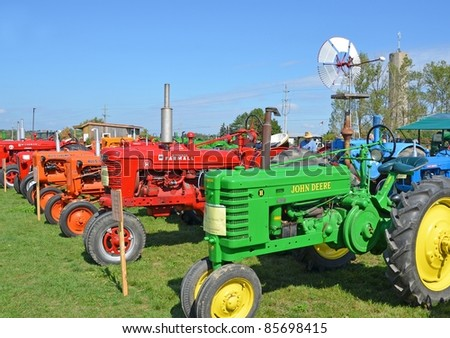 ANCASTER, ONTARIO, CANADA - SEPTEMBER 24:a large assortment of vintage farm tractors on  display  at the Ancaster Fall Fair on September 24, 2011 in Ancaster, Ontario, Canada - stock photo