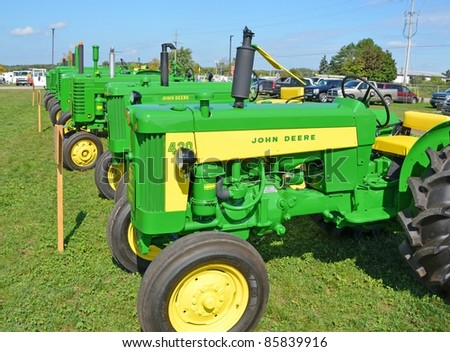 ANCASTER, ONTARIO, CANADA - SEPTEMBER 24: An assortment of vintage John Deere farm tractors on display at the Ancaster Fall Fair on September 24, 2011 in Ancaster, Ontario, Canada - stock photo