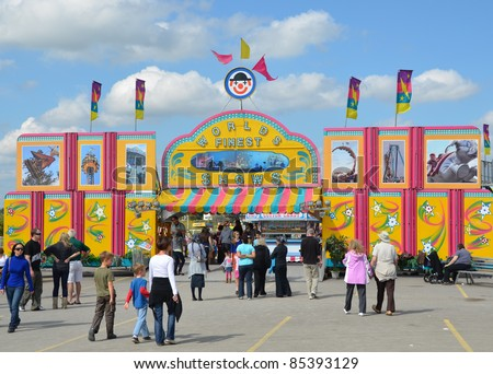 ANCASTER, ONTARIO, CANADA - SEPTEMBER 24: Fair visitors mingle around the Worlds finest Midway  entrance at the yearly Ancaster Fair on September 24, 2011 in Ancaster, Ontario, Canada