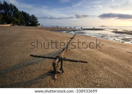Anchor boat view during sunrise at the beach of Tanjung bungah, Penang Malaysia - stock photo