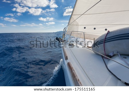 Anchor, forestay and furling drum on the yacht bow in sea  - stock photo