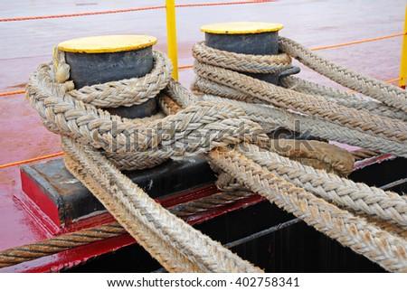 Anchor ropes at Ravenna Harbor. - stock photo