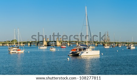 Anchored boats in the Matanzas river in St. Augustine, Florida. View of the Bridge of Lions in the background - stock photo