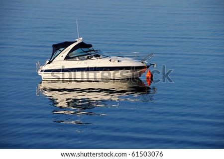 Anchored motor boat - stock photo