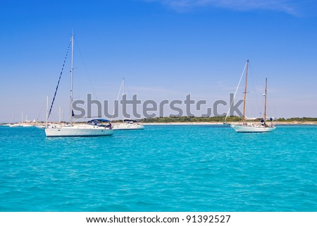 anchored sailboats in turquoise Formentera illetes beach near Ibiza
