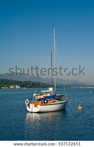Anchored sailboats on the Lake Woerther, Carinthia, Austria - stock photo