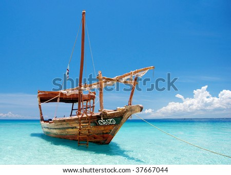 Anchored wooden dhow boat - stock photo