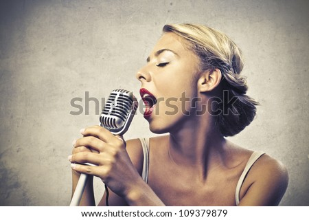 Anchorman reading the news into the microphone - stock photo