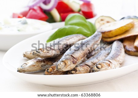 Anchovies with Chips and Farmer Salad - stock photo