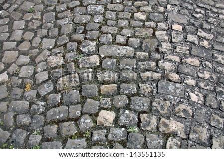 Ancient a cobblestone road - stock photo