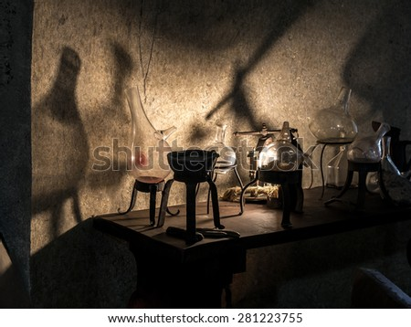 Ancient alchemist's lab with instruments and equipment - stock photo