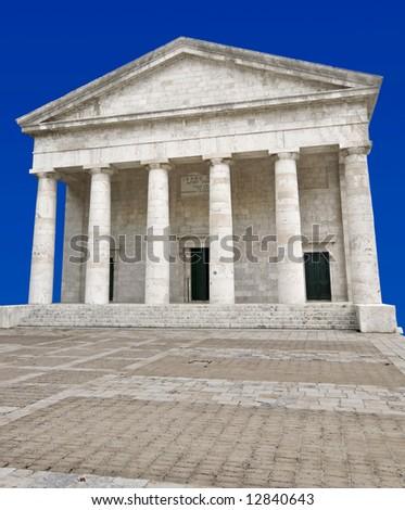 Ancient alike modern Greek temple at Corfu island, Greece ready cropped on blue background - stock photo