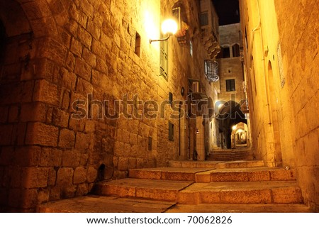 Ancient Alley in Jewish Quarter ay Night, The Old City Jerusalem - stock photo