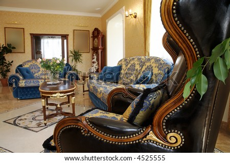 Ancient and leather armchair in rich hotel