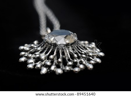 Ancient antique silver necklace with gem stone. - stock photo