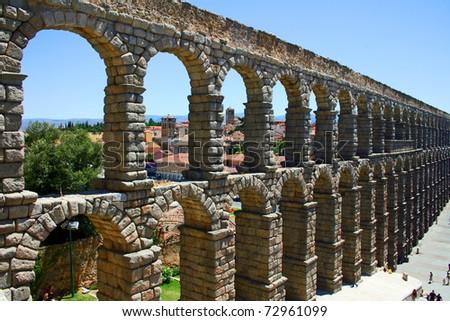 Ancient aqueduct of roman in Segovia (Spain) - stock photo