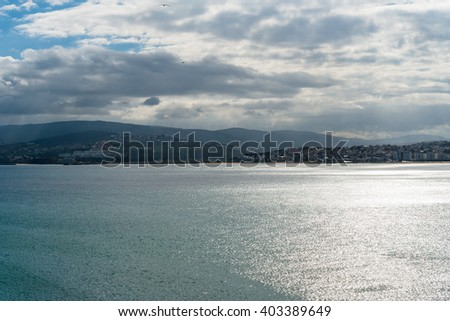 Ancient arabic city panorama view in Morocco Africa.  View at Port of Tangier on a sunny day against blue cloudy sky, image for travel tourism concept blog business website - stock photo