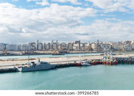 Ancient arabic city panorama view in Morocco Africa  View at Port of Tangier on a sunny day against blue cloudy sky, image for travel tourism concept blog business website - stock photo