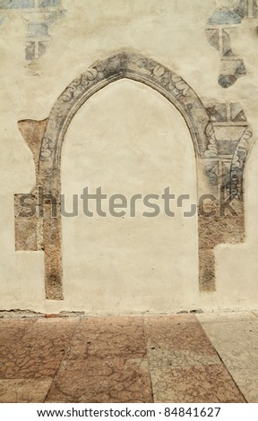 ancient arch on facade of the building in italian town Trento, Europe - stock photo