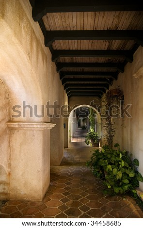 Ancient arched Mexican style village architecture with tiled flooring in Sedona's Arts & Crafts area. - stock photo