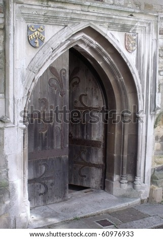 Ancient arched wooden doorway