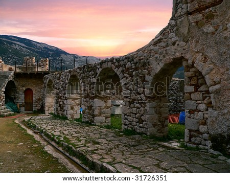 ancient arches in the site of a monastery in Greece under a beautiful sunset