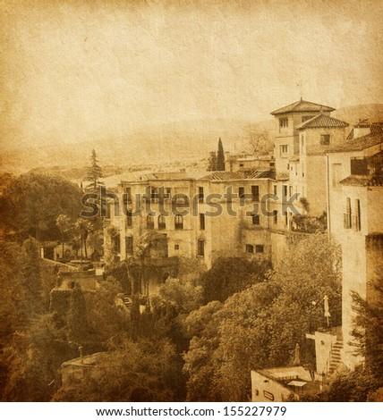 ancient architecture of Ronda, Andalusia,  Spain.     Photo in retro style. Added paper texture.