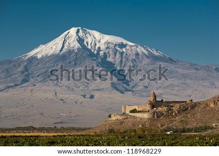 Ancient Armenian church Khor Virap with Ararat on the background. - stock photo