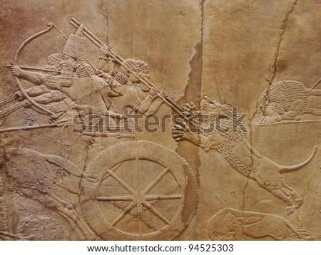 Ancient Assyrian wall carvings of men on a Royal lion hunt - stock photo