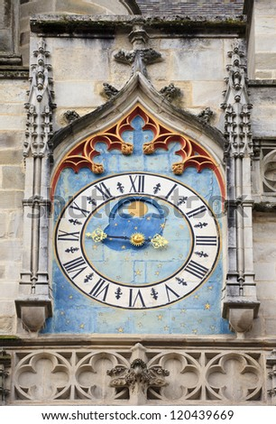 Ancient astronomical clock on the facade of famous Autun cathedral, France