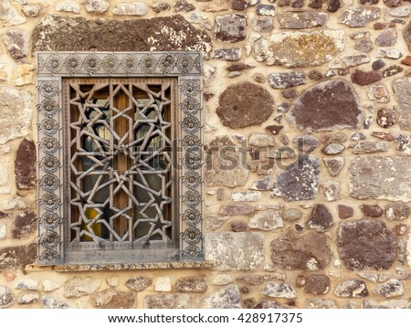Ancient background with oriental ornaments on the window. Wooden frame on the window, traditional arabic style of architecture in Turkey. - stock photo