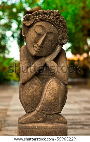 Ancient Bali statue, a great garden decoration. - stock photo