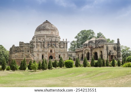 Ancient Bara Gumbad Tomb, Lodi Gardens, New Delhi, India - stock photo