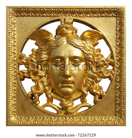 Ancient baroque golden mask on a fence at Palazzo Reale Turin Italy
