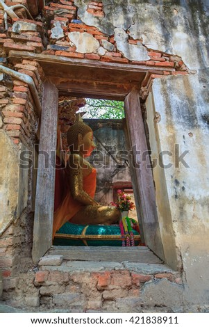Ancient big buddha image inside ruin church background - stock photo